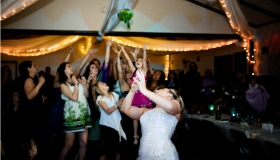 The tradition of tossing bouquet & garter at the wedding